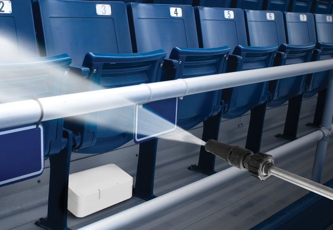 Wi-Fi Access Point Enclosure under stadium seat being power washed
